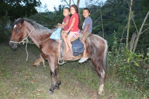 Frederick, Vivian and Yovany on their Uncle's horse.  This was taken last year.