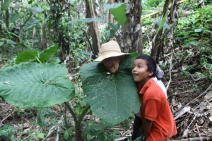 Jen  and Yovany hamming it up with broadleaf plant